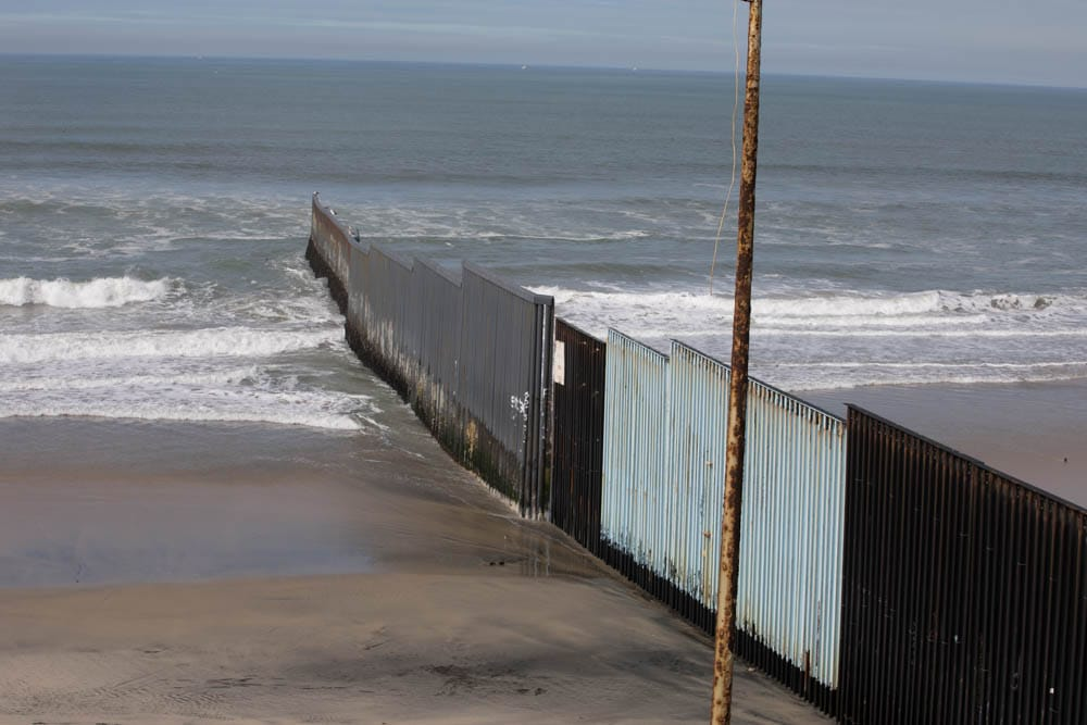 The_wall_between_the_USA_and_Mexico_ending_in_the_Pacific_Ocean_in_Tijuana_beach.jpg