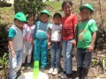 14. Teaching children how to plant trees  so they will have a nutricious and sustainable future
