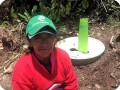 15. This Green Musketeer is proud of her just planted tree with the Waterboxx plant cocoon