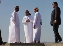 The interested visitors discuss the future of a green Oman