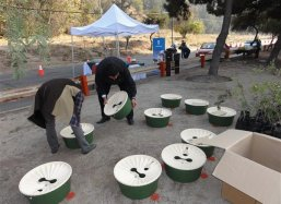 The assembling of the Groasis Waterboxx plantcocoons® to be planted during the ceremony